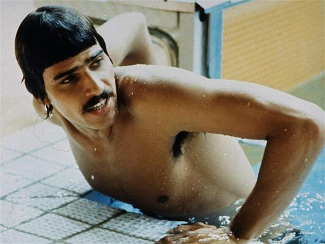 U.S. swimmer Mark Spitz, of Carmichael, Cal., emerges from the pool on September 3, 1972 after winning again for the United States in the 100 m freestyle Summer Olympic Games swimming event in Munich, Germany. (AP Photo)