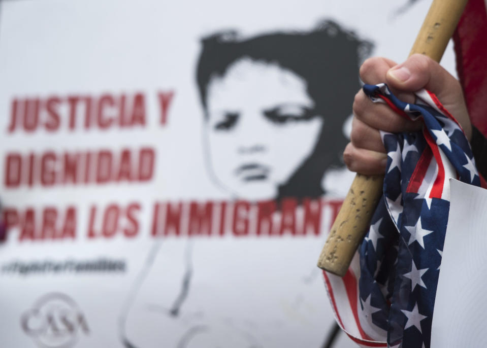 <p>A woman clutches a US national flag as other immigrants and activists protest near the White House to demand that the Department of Homeland Security extend Temporary Protected Status (TPS) for more than 195,000 Salvadorans on Jan. 8, 2018 in Washington. (Photo: Andrew Caballero-Reynolds/AFP/Getty Images) </p>