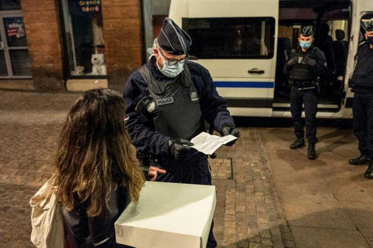 French police checked people out on the street after curfew in Toulouse and other cities from Saturday
