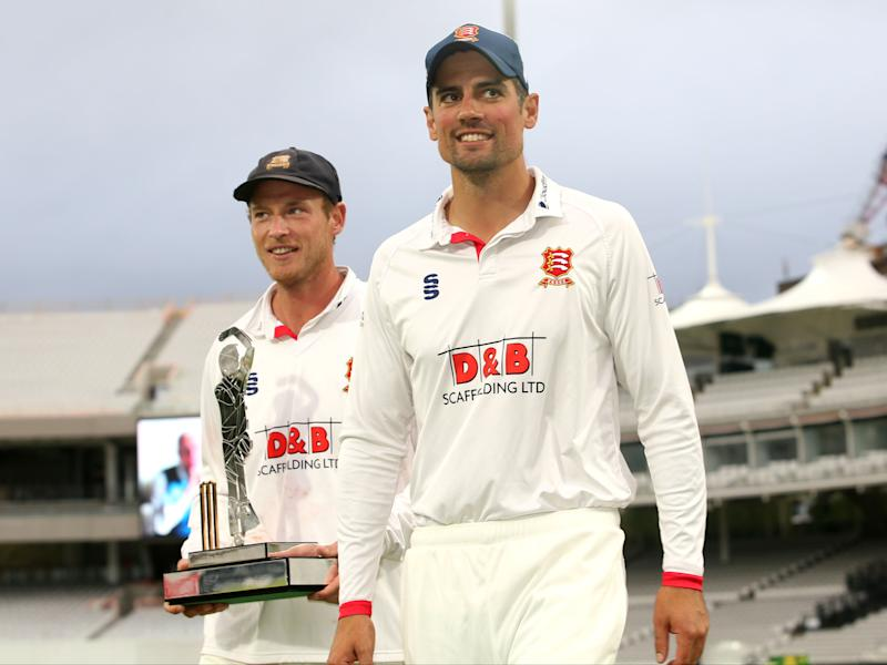 Sir Alastair Cook celebrates with Tom WestleyPA