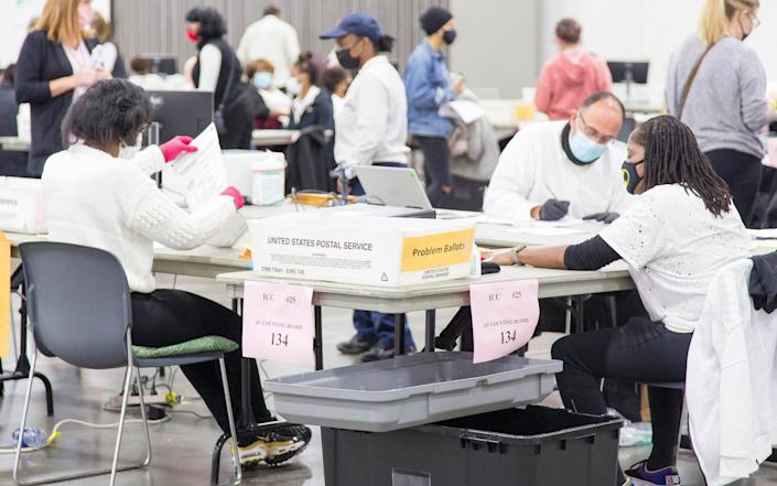Absentee Ballots are certified and then counted at TCF Center, in Detroit, Michigan - JEFFREY SAUGER/EPA-EFE/Shutterstock/Shutterstock