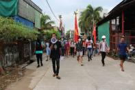 Students from a local univeristy stage a protest against the military coup, in Dawei