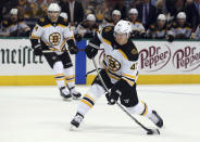 Boston Bruins defenseman Torey Krug (47) takes a shot on goal against the Dallas Stars in the second period of an NHL hockey game Friday, Nov. 16, 2018, in Dallas. (AP Photo/Richard W. Rodriguez)