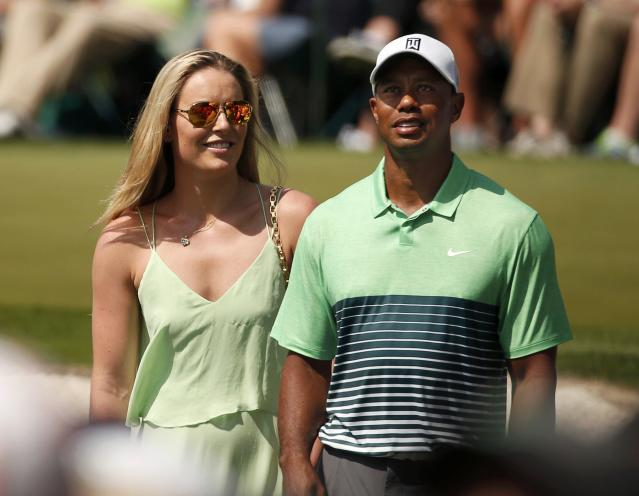 Skier Lindsey Vonn stands next to her boyfriend, U.S. golfer Tiger Woods, during the par 3 event held ahead of the 2015 Masters at Augusta National Golf Course in Augusta, Georgia April 8, 2015. REUTERS/Phil Noble