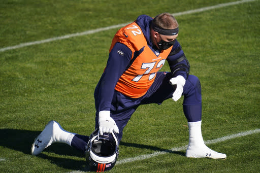 Denver Broncos offensive tackle Garett Bolles wears a face covering before he takes part in drills during an NFL football practice at the team's heasdquarters Wednesday, Nov. 25, 2020, in Englewood, Colo. (AP Photo/David Zalubowski)