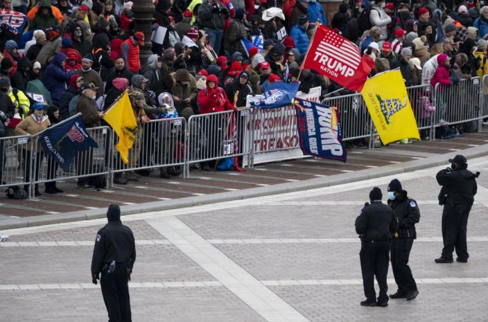 """<span class=""""caption"""">Gadsden flags fly at a protest Wednesday at the Capitol.</span> <span class=""""attribution""""><a class=""""link rapid-noclick-resp"""" href=""""https://www.gettyimages.com/detail/news-photo/capitol-police-line-the-barricades-as-trump-supporters-news-photo/1230452268"""" rel=""""nofollow noopener"""" target=""""_blank"""" data-ylk=""""slk:Bill Clark/CQ-Roll Call, Inc via Getty Images"""">Bill Clark/CQ-Roll Call, Inc via Getty Images</a></span>"""