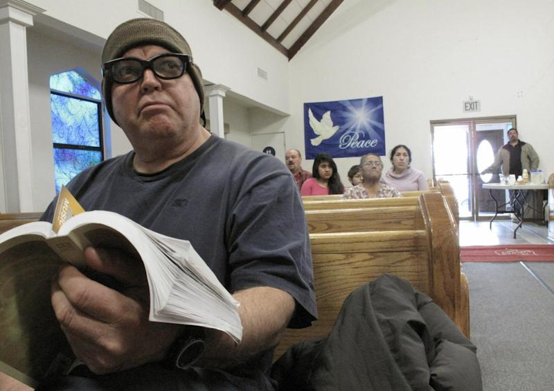 """In this Thursday Jan. 30, 2014, photo, forklift driver William Felix, 56, attends a devotional at the Salvation Army in Los Banos, Calif. Now unemployed, Felix said that he has been to a local cannery four times this winter asking for work with no luck. He doubts a call will come at all this year, given the state's drought. """"If we don't get rain, we don't get work,"""" Felix said. For now, he relies on free food from the Salvation Army as well as a spiritual boost. (AP Photo/Scott Smith)"""