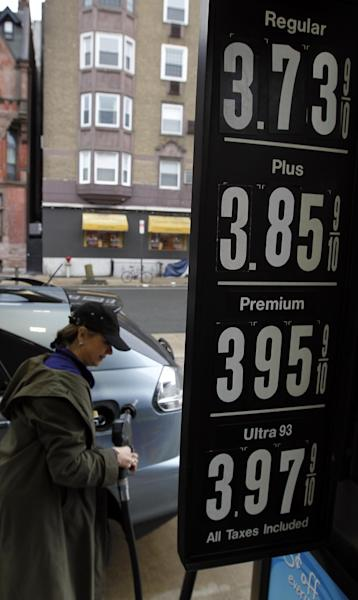 Deborah Delauro removes the nozzle after putting gas in her car Friday, Feb. 24, 2012 in Philadelphia. The price of gasoline, which is made from crude oil, has soared as oil prices rise. The national average jumped by nearly 12 cents per gallon in a week, with state averages above $4 per gallon in California, Alaska and Hawaii. (AP Photo/Alex Brandon)