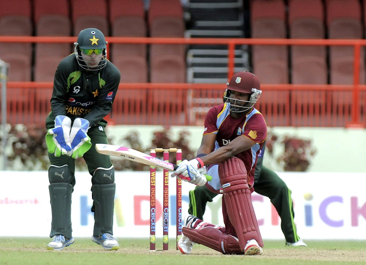 West Indies batsman Darren Bravo sweeping Pakistan bowler Saeed Ajmal the during the 2nd ODI West Indies v Pakistan at Guyana National Stadium in Georgetown July 16, 2013. The wicket-keeper is Umar Akmal. Score, WI 50/1 (10 ov).   AFP PHOTO / Randy Brooks        (Photo credit should read RANDY BROOKS/AFP/Getty Images)