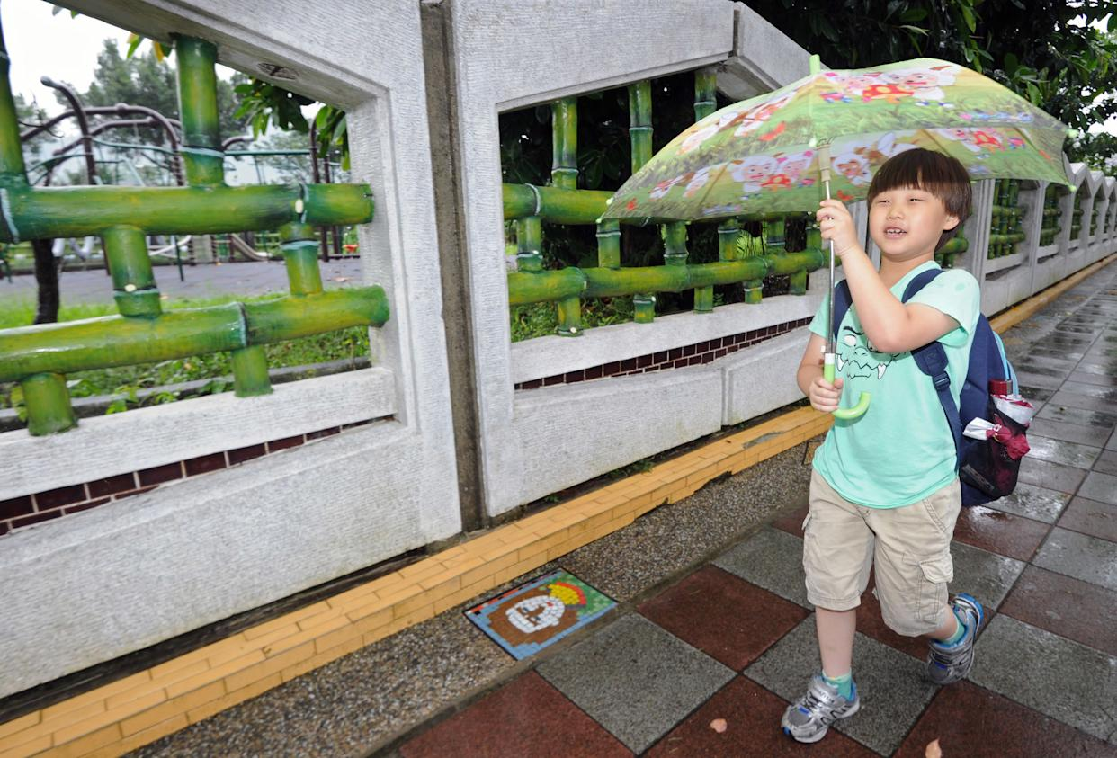 This picture, taken June 5, 2013, shows 7-year-old elementary school student Ryan Kao walking to school in Taipei, the capital of Taiwan.