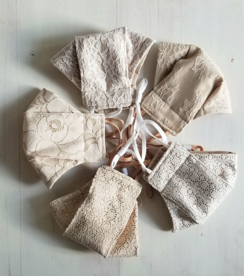 five Nude Lace Reusable Face Masks sitting on white table