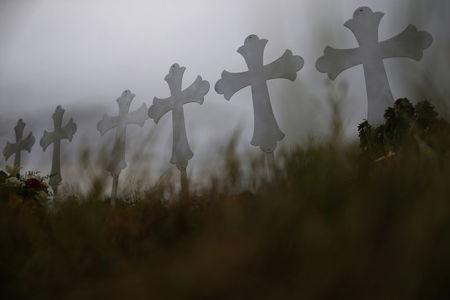 Crosses are seen placed at a memorial in memory of the victims killed in the shooting at the First Baptist Church of Sutherland Springs in Sutherland Springs, Texas, U.S., November 8, 2017. REUTERS/Jonathan Bachman