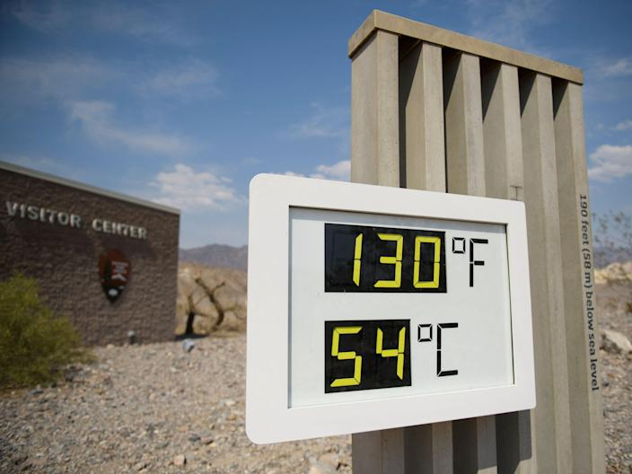 A thermometer display showing record high temperatures in Death Valley National Park
