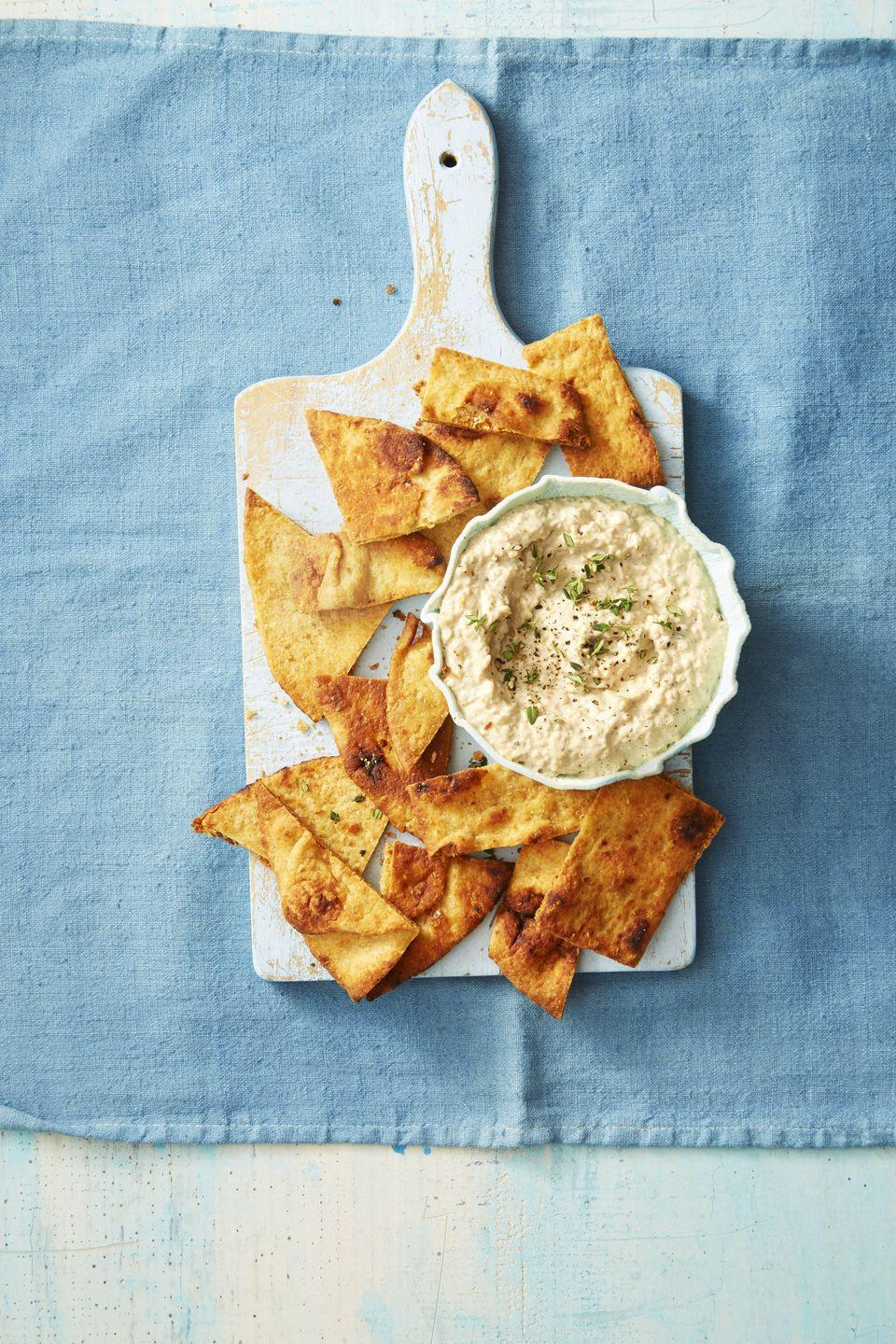 """<p>This classic party starter gets a smoky kick from a few minutes on the BBQ.</p><p><em><a href=""""https://www.goodhousekeeping.com/food-recipes/a38842/grilled-onion-dip-recipe/"""" rel=""""nofollow noopener"""" target=""""_blank"""" data-ylk=""""slk:Get the recipe for Grilled Onion Dip »"""" class=""""link rapid-noclick-resp"""">Get the recipe for Grilled Onion Dip »</a></em></p>"""