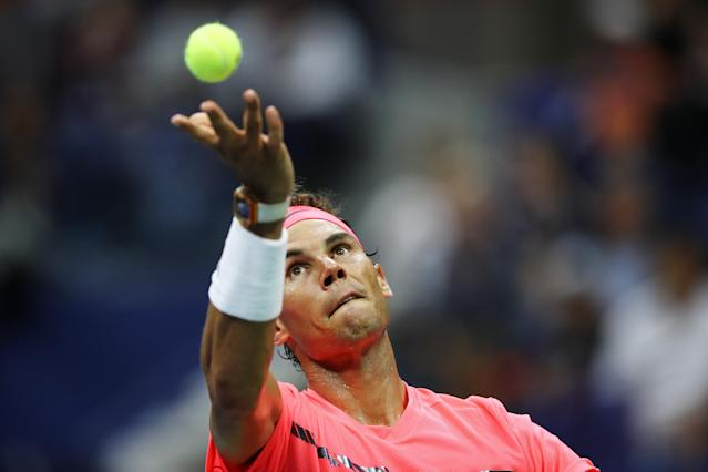 <p>Rafael Nadal of Spain serves to Dusan Lajovic of Serbia & Montenegro during their first round Men's Singles match on Day Two of the 2017 US Open at the USTA Billie Jean King National Tennis Center on August 29, 2017 in the Flushing neighborhood of the Queens borough of New York City. (Photo by Elsa/Getty Images) </p>