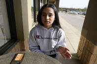 Komalpreet Kaur explains the Vaisakhi holiday during an interview at a coffee shop in Overland Park, Kan., Monday, April 12, 2021. Sikhs across the U.S. are holding toned-down Vaisakhi celebrations this week, joining people of other faiths in observing major holidays cautiously this spring as COVID-19 keeps an uneven hold on the country. Vaisakhi marks the day in 1699 when Sikhism took its current form. (AP Photo/Orlin Wagner)