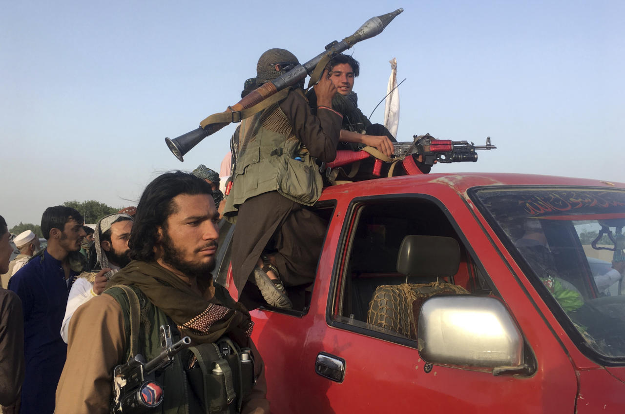 <p> Taliban fighters ride in their vehicle in Surkhroad district of Nangarhar province, east of Kabul, Afghanistan, Saturday, June 16, 2018. A suicide bomber blew himself up in eastern Afghanistan on Saturday as mostly Taliban fighters gathered to celebrate a three-day cease fire marking the Islamic holiday of Eid al-Fitr, killing 21 people and wounding another 41, said the Nangarhar provincial Police Chief Ghulam Sanayee Stanikzai. Most of the dead and wounded were believed to be Taliban, he said. (AP Photo/Rahmat Gal) </p>