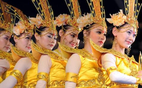 Dancers from the Central Ethnic Song and Dance Ensemble perform during a Chinese New Year celebration in Trafalgar Square, London - Credit: Fiona Hanson/PA Wire