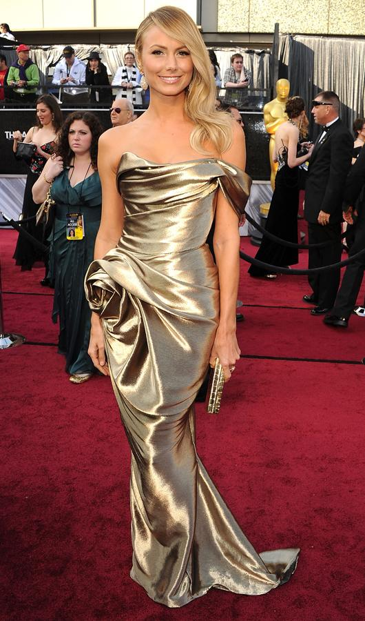 Celebrity fashion gold dresses: Stacy Keibler wasn't content with having George Clooney on her at at the Oscars, she also had to wear this stunning Marchesa gown too. Not fair!