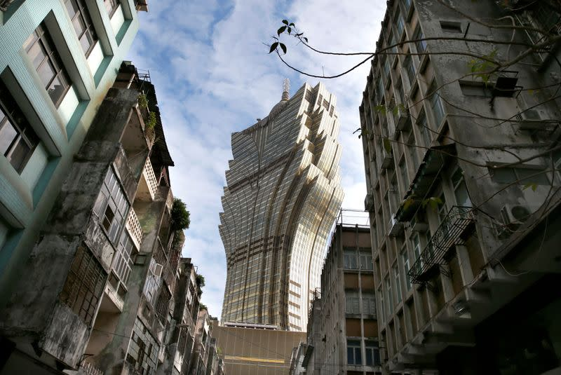 The Grand Lisboa hotel is seen near old apartment blocks in Macau