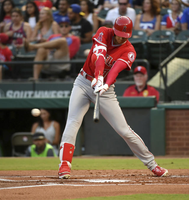 Los Angeles Angels designated hitter Shohei Ohtani connects on an RBI single off Texas Rangers starting pitcher Ariel Jurado during the first inning of a baseball game, Thursday, Aug. 16, 2018, in Arlington, Texas. (AP Photo/Jeffrey McWhorter)