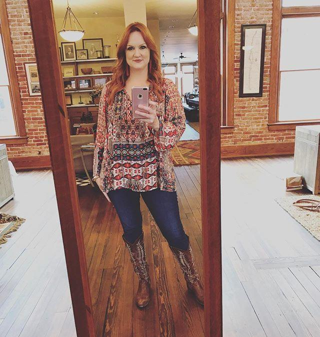 "<p>Here, Ree poses in a warm-toned tunic that totally complements her red hair. ""Same general jeans, same general boots; I just swap out the top depending on my mood,"" she captioned this post.</p><p><a href=""https://www.instagram.com/p/BZHpe1LhkPD/?utm_source=ig_embed&utm_campaign=loading"" rel=""nofollow noopener"" target=""_blank"" data-ylk=""slk:See the original post on Instagram"" class=""link rapid-noclick-resp"">See the original post on Instagram</a></p>"