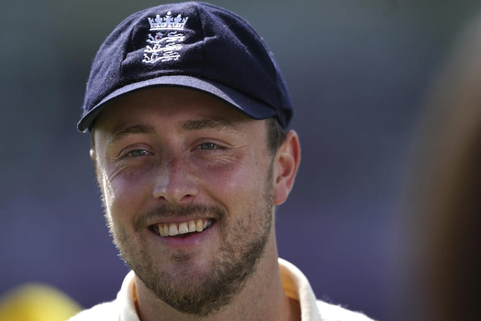 England's Ollie Robinson smiles during the presentation ceremony after their win on the fourth day of third test cricket match between England and India, at Headingley cricket ground in Leeds, England, Saturday, Aug. 28, 2021. (AP Photo/Jon Super)