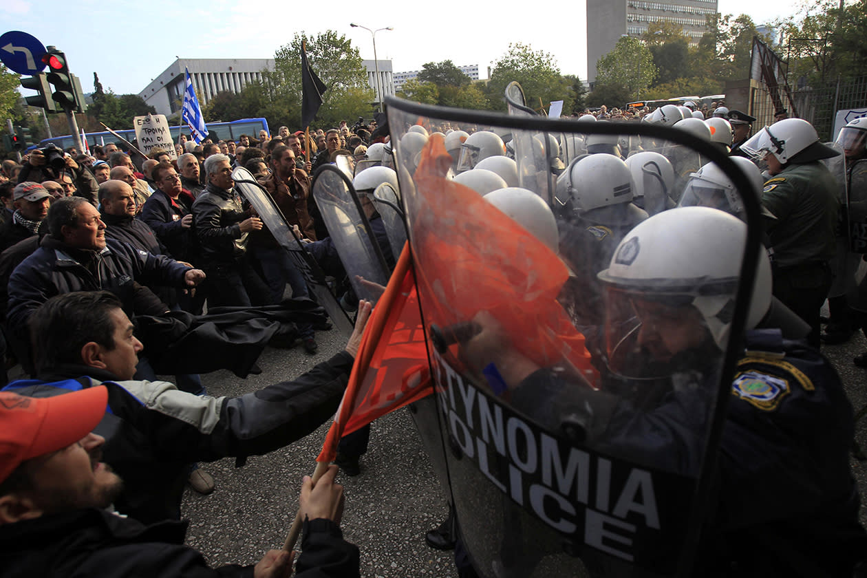 Protesters clash with police before a conference of Greek and German mayors in the northern Greek port city of Thessaloniki.