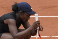 United States's Sloane Stephens reacts after missing a point as she plays against Czech Republic's Karolina Muchova during their third round match on day 7, of the French Open tennis tournament at Roland Garros in Paris, France, Saturday, June 5, 2021. (AP Photo/Christophe Ena)