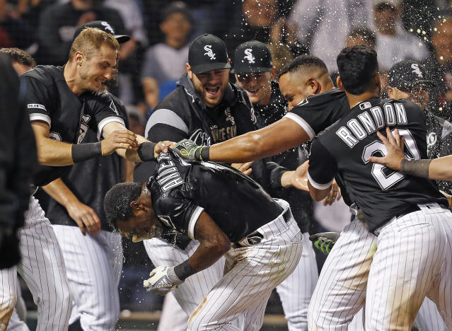 Chicago White Sox Tim Anderson (7) celebrates with teammates following his walk-off home run against the Detroit Tigers during the ninth inning of a baseball game Friday, April 26, 2019, in Chicago. The Chicago White Sox won 12-11. (AP Photo/Nuccio DiNuzzo)