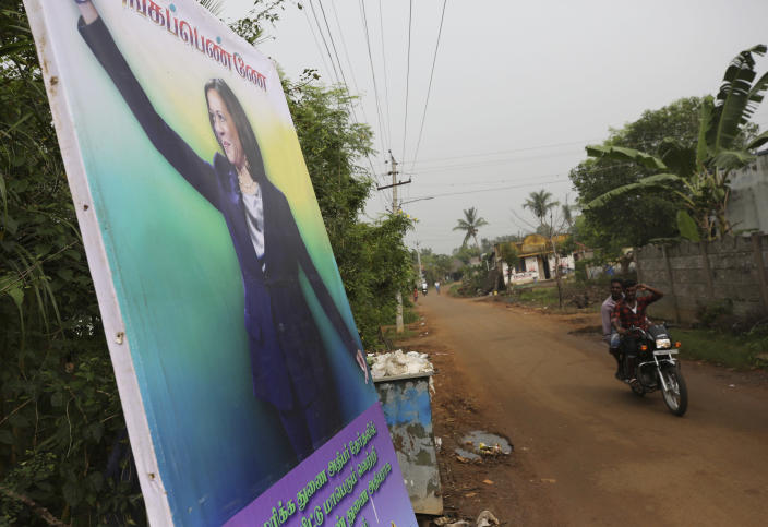 A banner featuring U.S. Vice President-elect Kamala Harris with a message wishing her the best is displayed in Thulasendrapuram, the hometown of Harris' maternal grandfather, south of Chennai, Tamil Nadu state, India, Wednesday, Jan. 20, 2021. The inauguration of President-elect Joe Biden and Vice President-elect Kamala Harris is scheduled be held today. (AP Photo/Aijaz Rahi)