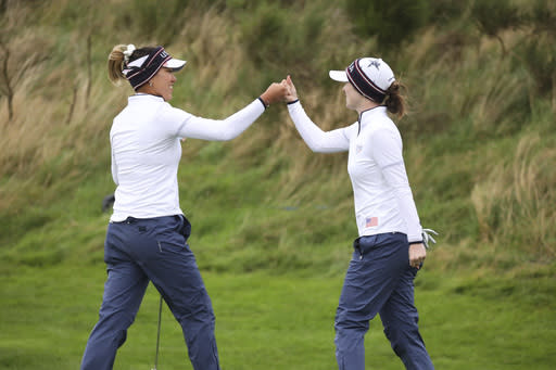 Annie Park of the US celebrates with Brittany Altomare after holing a putt on the 9th hole during the Fourballs match against Europe in the Solheim cup at Gleneagles, Auchterarder, Scotland, Saturday, Sept. 14, 2019. (AP Photo/Peter Morrison)