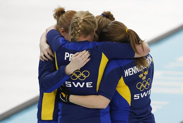 Sweden celebrates their victory over Switzerland in the women's curling semifinal game against at the 2014 Winter Olympics, Wednesday, Feb. 19, 2014, in Sochi, Russia. (AP Photo/Robert F. Bukaty)