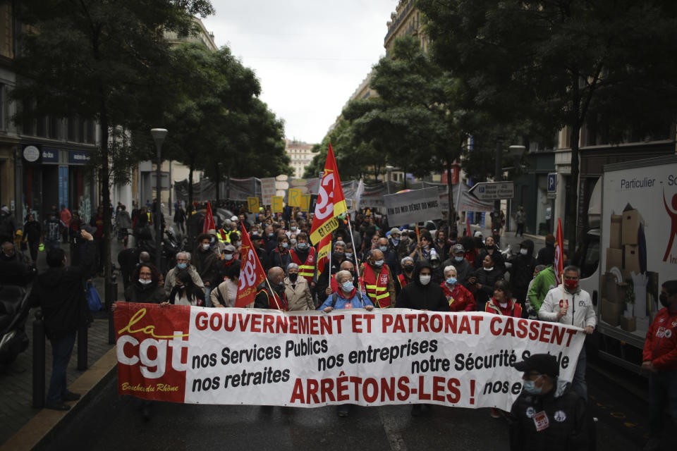 Workers of the leftist union CGT (General Work Confederation) demonstrate on May Day in Marseille, southern France, Saturday, May 1, 2021. (AP Photo/Daniel Cole)