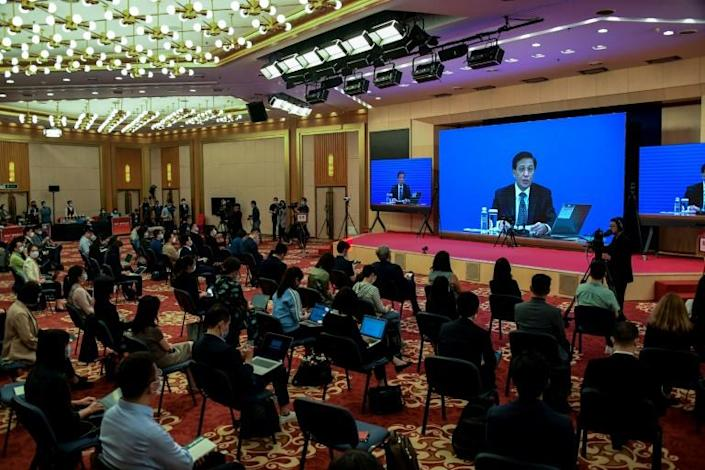 Zhang Yesui, seen here on the screen during a video press conference in Beijing on May 21, 2020, said China's parliament considered the move necessary (AFP Photo/LEO RAMIREZ)