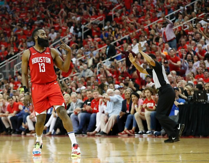 c757a3b41875 Houston  39 s James Harden celebrates a three-point shot in the Rockets