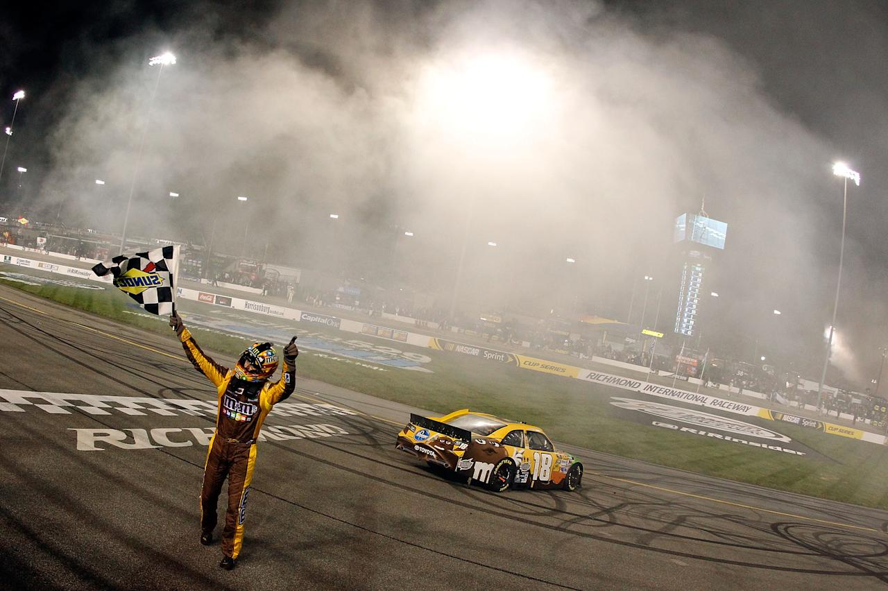 RICHMOND, VA - APRIL 28:  Kyle Busch, driver of the #18 M&M's Ms. Brown Toyota, celebrates with the checkered flag after winning the NASCAR Sprint Cup Series Capital City 400 at Richmond International Raceway on April 28, 2012 in Richmond, Virginia.  (Photo by Tom Pennington/Getty Images for NASCAR)