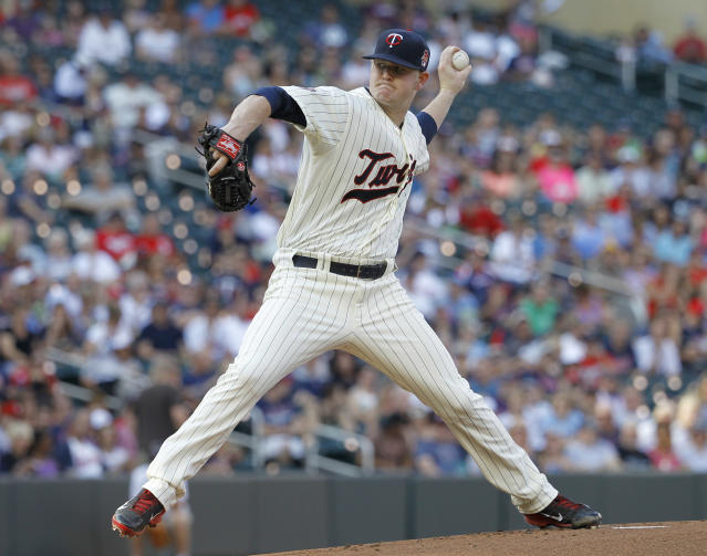 Minnesota Twins starting pitcher Logan Darnell delivers to the Chicago White Sox during the first inning of a baseball game in Minneapolis, Saturday, July 26, 2014. (AP Photo/Ann Heisenfelt)
