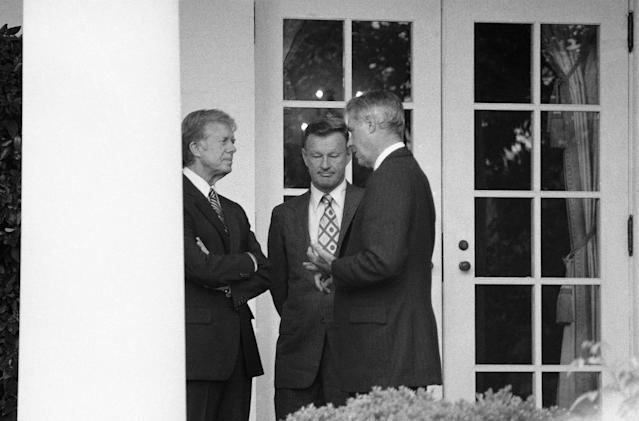 <p>President Carter chats with Secretary of State Cyrus Vance, right, and National Security Adviser Zbigniew Brzezinski outside the White House in Washington on Tuesday, Sept. 11, 1979. The three men confer moments before Carter welcomed an official visitor to the Rose Garden. (Photo: Georges/AP) </p>