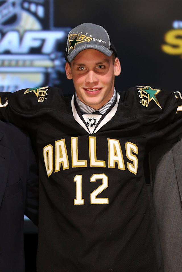 PITTSBURGH, PA - JUNE 22: Radek Faksa, 13th overall pick by the Dallas Stars, poses on stage during Round One of the 2012 NHL Entry Draft at Consol Energy Center on June 22, 2012 in Pittsburgh, Pennsylvania. (Photo by Bruce Bennett/Getty Images)