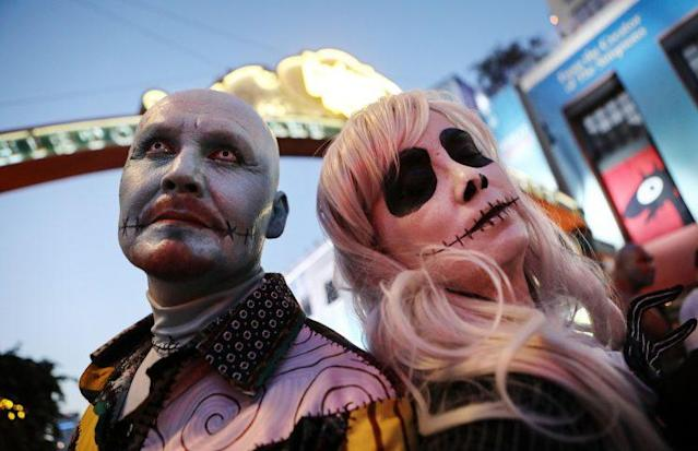 Cosplayers pose on the street outside San Diego Comic-Con on July 19, 2018 in San Diego, California. Thousands of revelers are arriving for the festivities at the annual comic and entertainment convention. (Photo by Mario Tama/Getty Images)