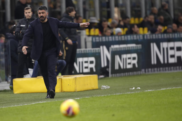 Napoli's head coach Gennaro Gattuso directs his team during an Italian Cup soccer match between Inter Milan and Napoli at the San Siro stadium, in Milan, Italy, Wednesday, Feb. 12, 2020. (AP Photo/Antonio Calanni)