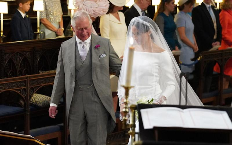 Prince Charles accompanies Meghan down the aisle at her Windsor wedding to Prince Harry - PA