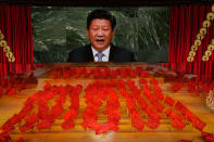 FILE - In this June 28, 2021, file photo, Chinese President Xi Jinping is displayed on a screen as performers dance at a gala show ahead of the 100th anniversary of the founding of the Chinese Communist Party in Beijing. U.S. President Joe Biden, his Chinese counterpart Xi Jinping, Japanese Prime Minister Yoshihide Suga and Russian President Vladimir Putin are among Pacific Rim leaders gathering for a virtual meeting on Friday, July 16, 2021, to discuss strategies to help economies rebound from a resurgent COVID-19 pandemic. (AP Photo/Ng Han Guan, File)