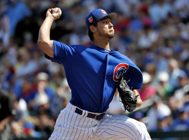Chicago Cubs pitcher Yu Darvish throws during the first inning of a spring training baseball game against the Los Angeles Dodgers, Tuesday, March 6, 2018, in Mesa, Ariz. (AP Photo/Matt York)
