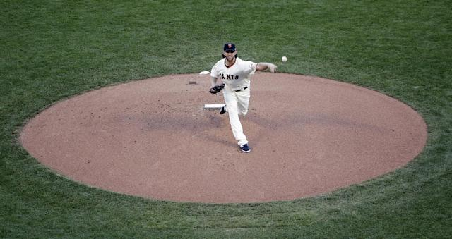 San Francisco Giants' Madison Bumgarner delivers a pitch during the first inning of Game 5 of baseball's World Series against the Kansas City Royals on Sunday, Oct. 26, 2014, in San Francisco. (AP Photo/Marcio Jose Sanchez)
