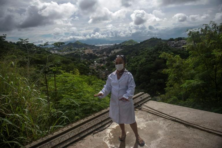 Suelen da Silva shows the site where she plans to build a new doll hospital near her home in Niteroi, which overlooks Guanabara Bay