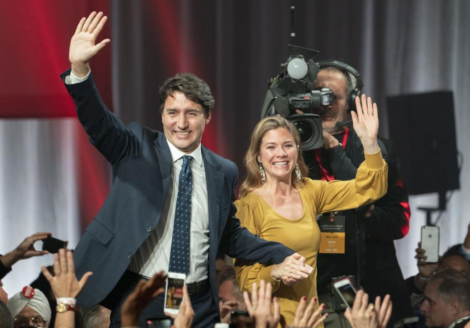 Liberal leader Justin Trudeau and wife Sophie Gregoire Trudeau wave as they go on stage at Liberal election headquarters in Montreal, Monday, Oct. 21, 2019. THE CANADIAN PRESS/Paul Chiasson
