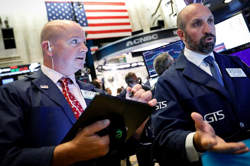 Traders work on the floor at the New York Stock Exchange (NYSE) in New York, U.S., August 5, 2019. REUTERS/Brendan McDermid