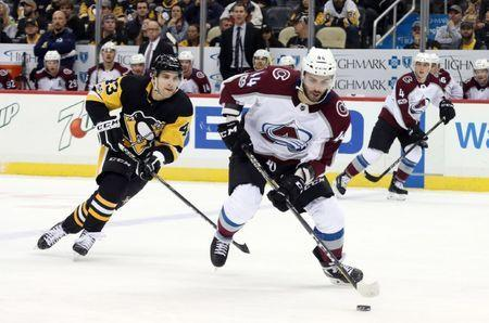 Dec 11, 2017; Pittsburgh, PA, USA; Colorado Avalanche defenseman Mark Barberio (44) skates with the puck ahead of Pittsburgh Penguins left wing Conor Sheary (43) during the third period at PPG PAINTS Arena. The Avalanche won 2-1. Mandatory Credit: Charles LeClaire-USA TODAY Sports